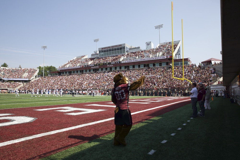 University of Montana Grizzlies Monte waving to the crowd of fans at a Griz football game.
